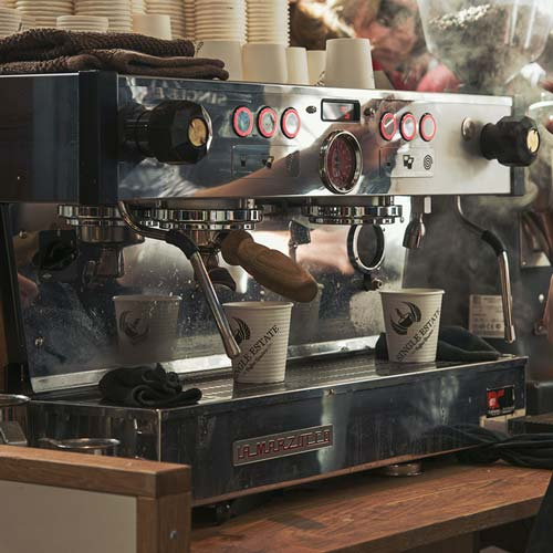 A commercial espresso machine inside a coffee shop.
